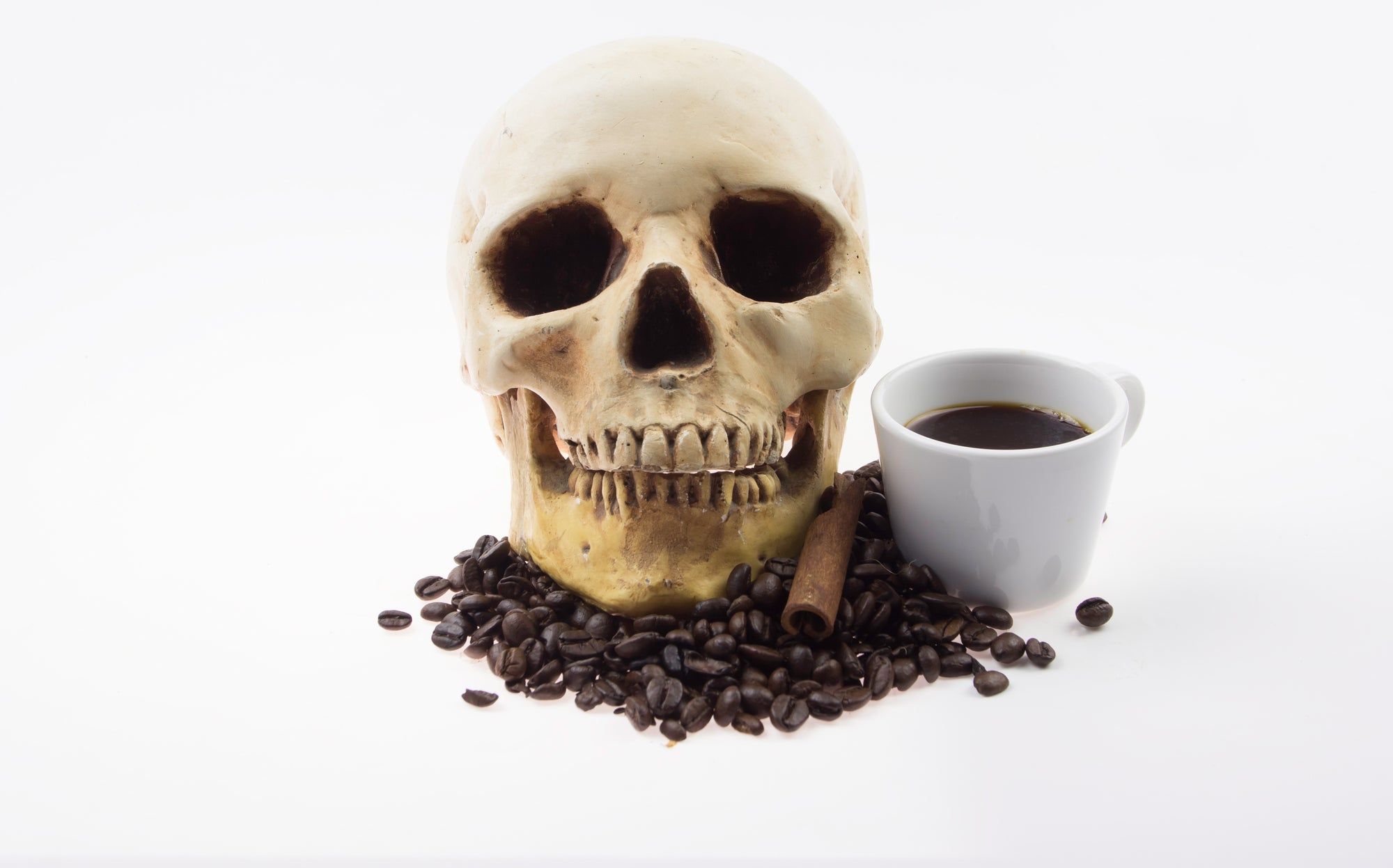 a skull and some coffee beans