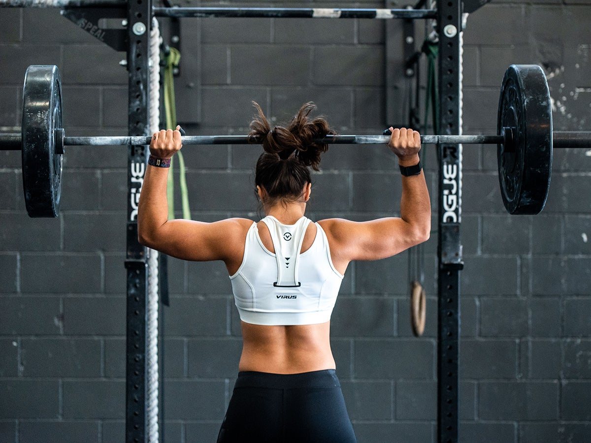 Person lifting weights in a gym.