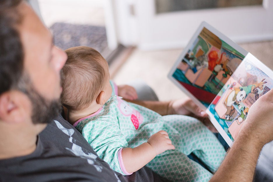 guy reading to his child