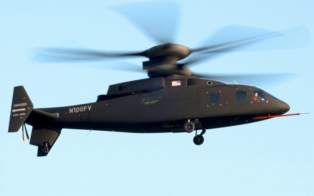 """SB>1 Defiant"""" class=""""wp-image-37681″/><figcaption>SB>1 Defiant by Sikorsky and Boeing A lightning-fast chopper. Instead of relying on a regular tail rotor to keep it from spinning in circles, Sikorsky and Boeing's SB>1 Defiant helicopter holds steady with a pair of 56-foot rigid carbon-fiber rotors that spin in opposite directions from each other. The chopper, which grew out of a long-running Sikorsky program known as """"X2,"""" also boasts what's called a pusher prop in the back—an addition that should let the bird hit 288 mph or more. That's incredibly fast for choppers, which typically cruise around 150 mph. Someday craft like this could replace slower, old-school Black Hawks as they carry up to a dozen soldiers into combat. <i>Sikorsky</i></figcaption></figure>         </div>         <div class="""