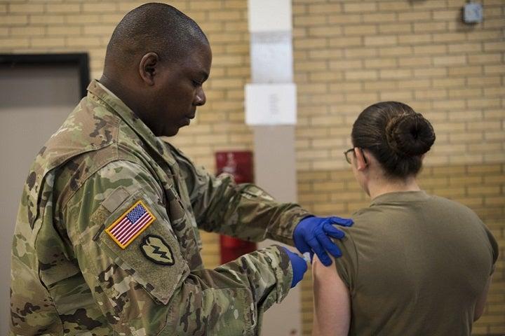 A U.S. service member gets a flu vaccination.