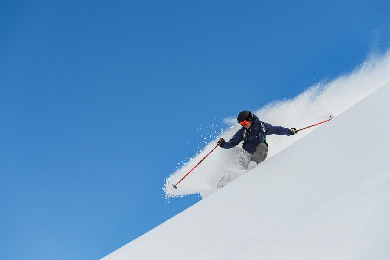 person skiing down a mountain