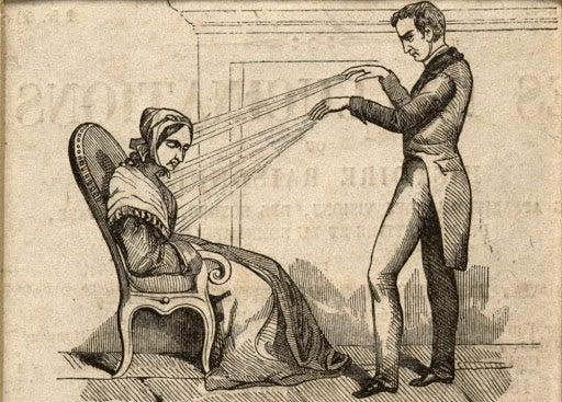 a man hypnotizing a woman