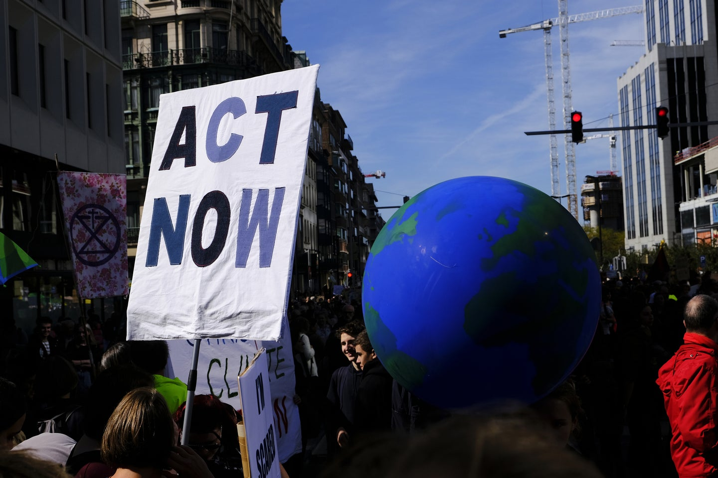 a large globe held up at a protest