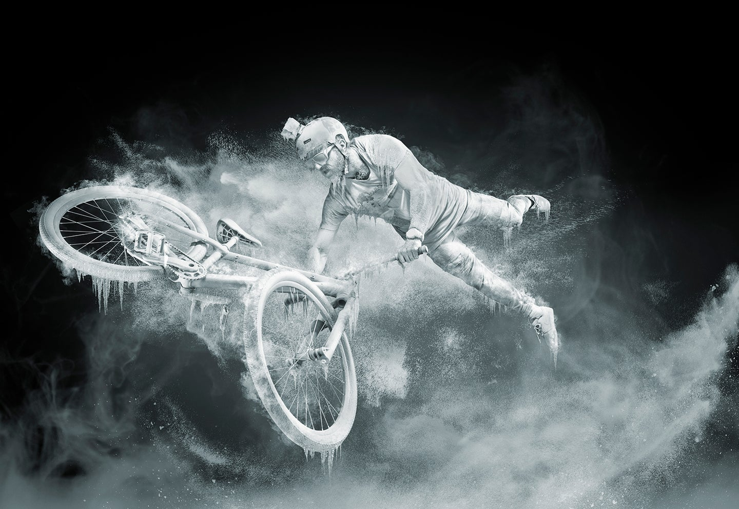 Paul Alekhin covered in ice and snow on bicycle