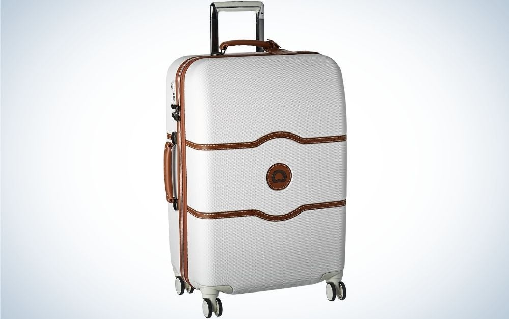 Champagne White Hardside Luggage with Spinner Wheels designed with stylish faux leather accents from front.