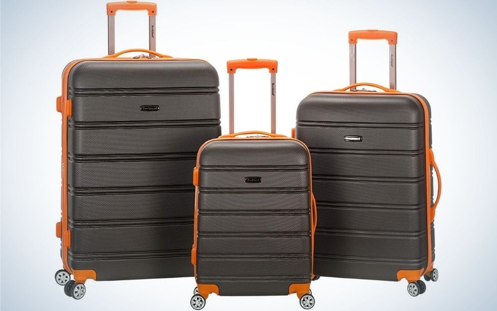3-Piece Set of charcoal and orange spinner wheel carry-on luggage of different sizes from front.