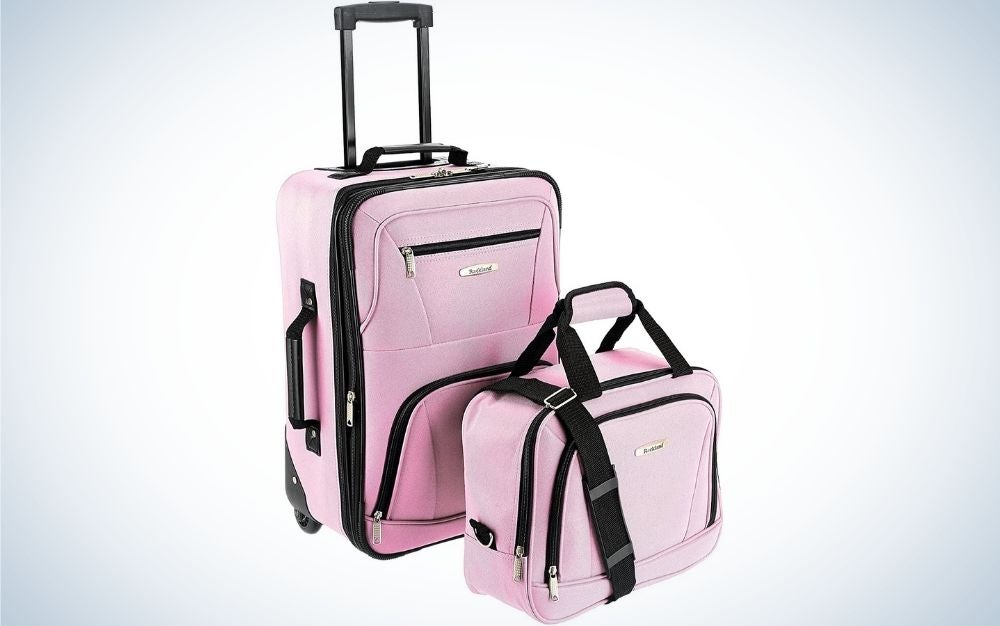 2 Pink luggage with two wheels and without wheels with telescoping and side grip handles from front.