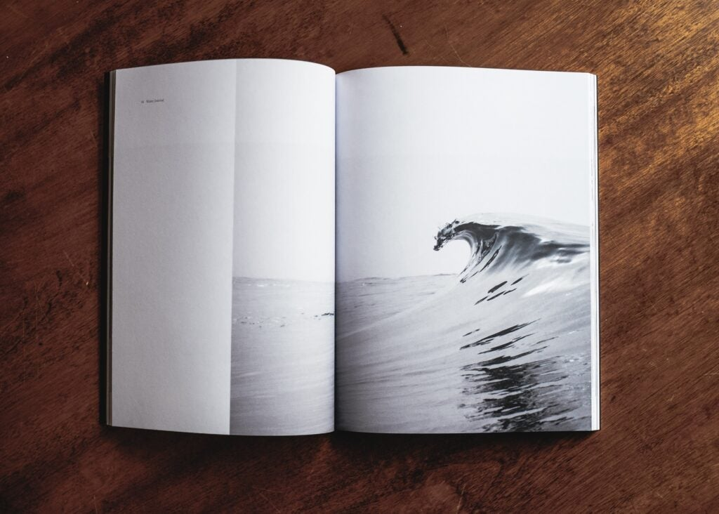 Photography book on wooden table.