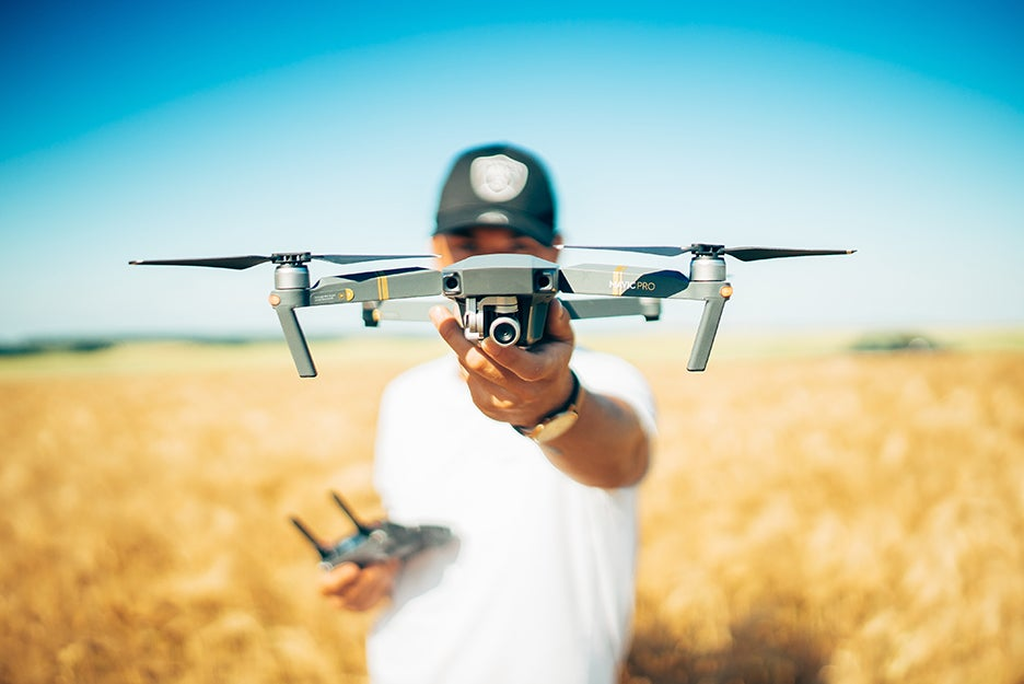 Guy with a drone in a field