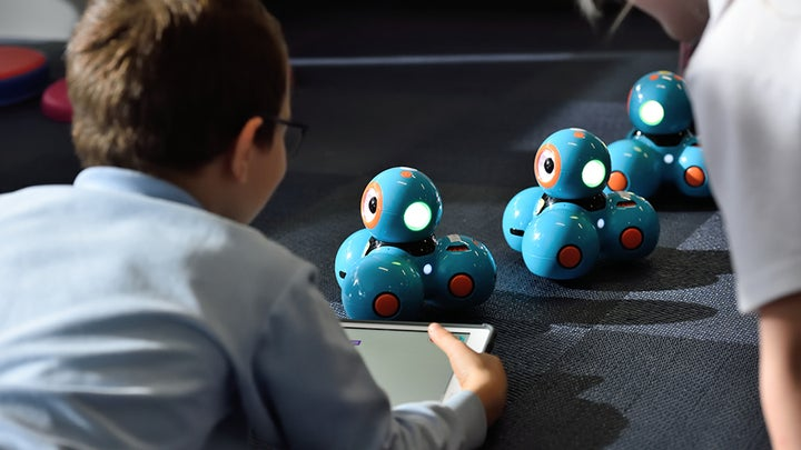 kid playing with stem robot
