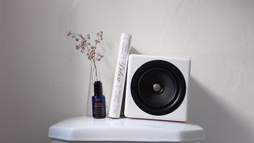 speaker and book on top of toilet