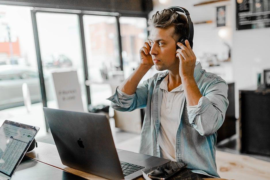 guy wearing headphones in an office