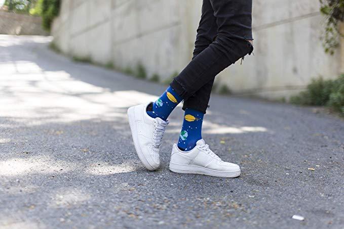 person wearing planet socks