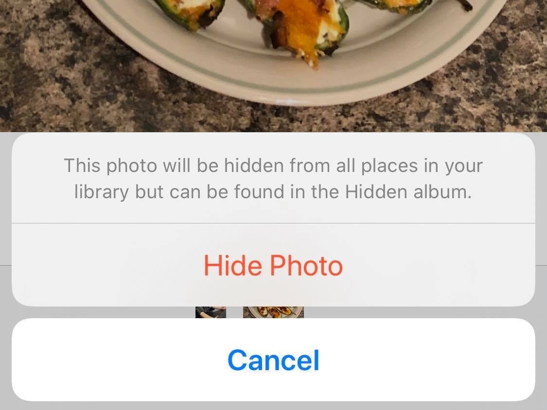 An iOS option to hide a photo of jalapeño poppers from being visible to anyone viewing your camera roll.