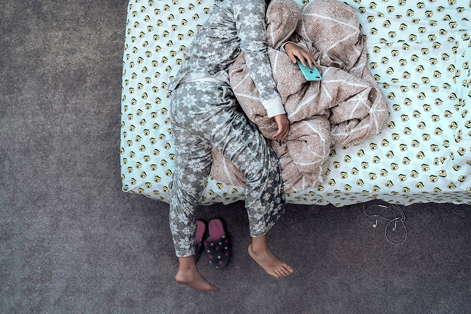 woman laying on bed in pajamas