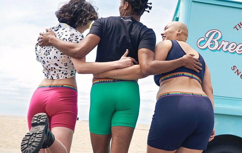 three people standing in underwear