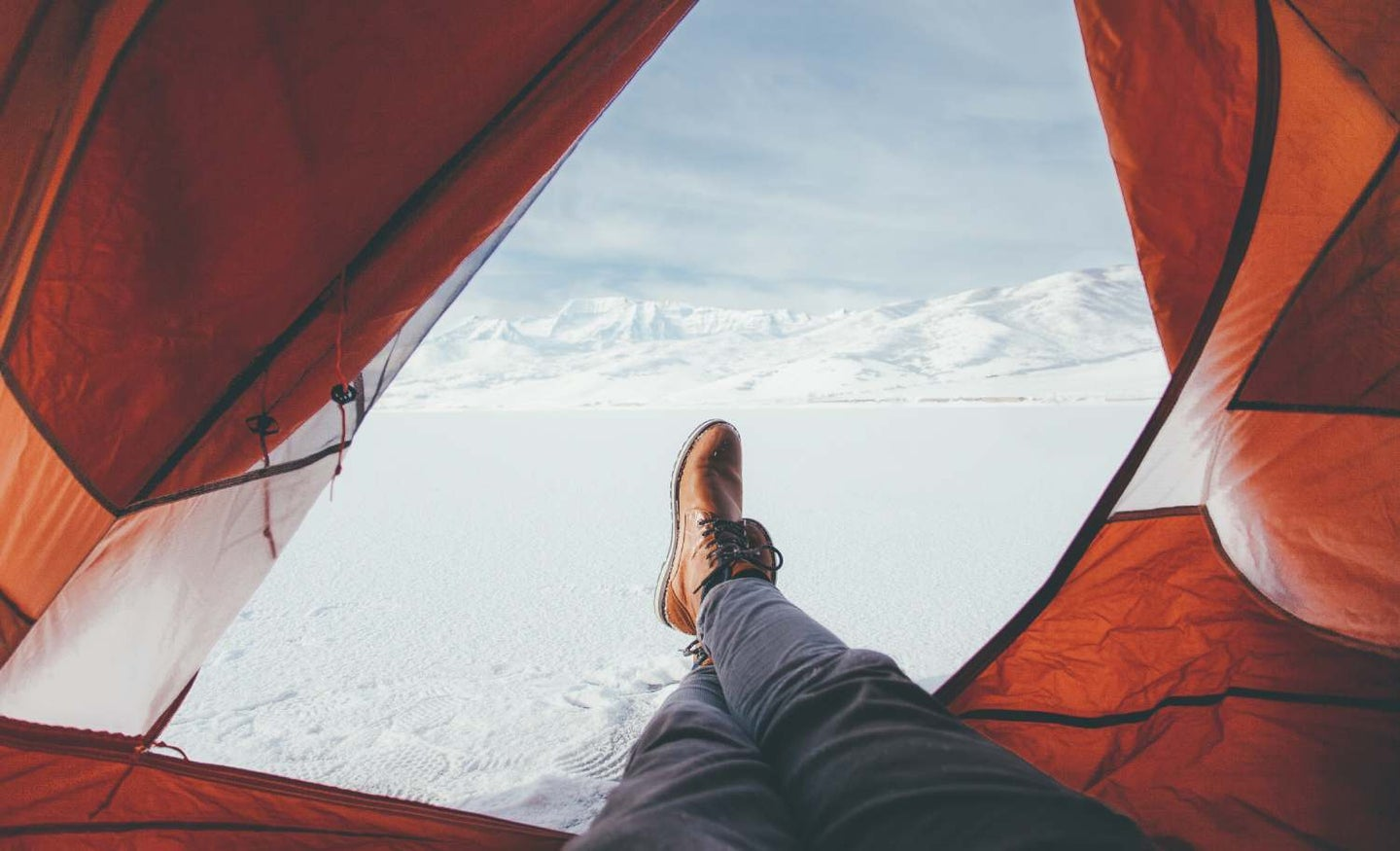 Person camping in the snow