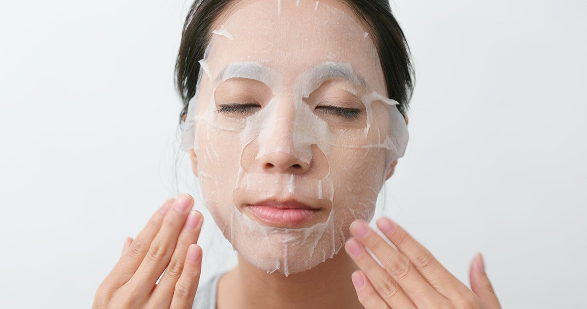 woman with a sheet mask on