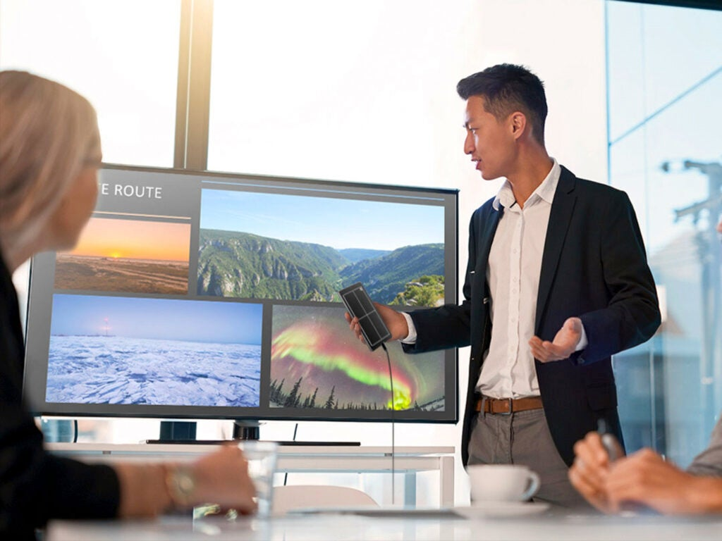 Person presenting in a meeting using Samsung DeX