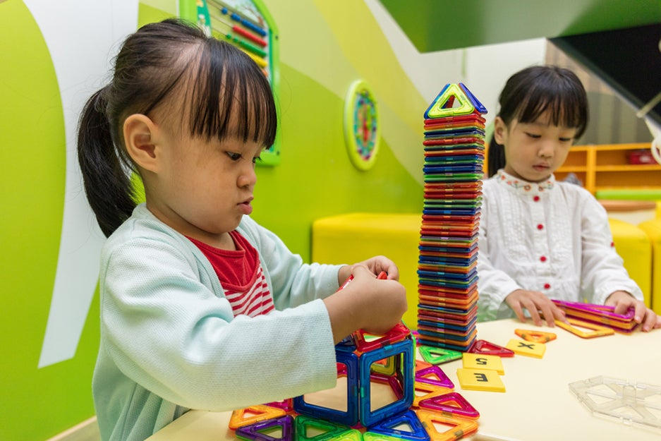 kids playing with magnetic building blocks