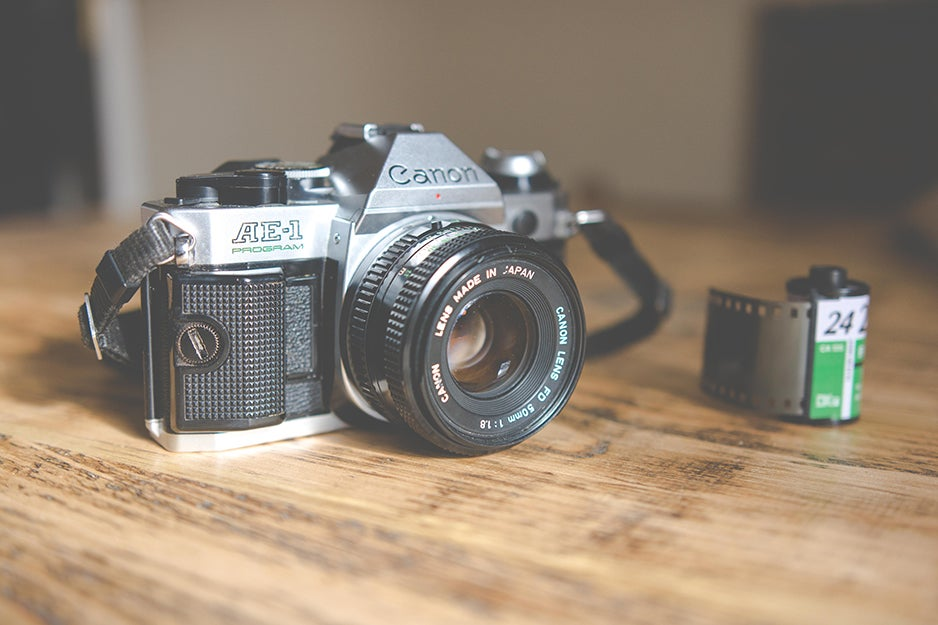 canon ae-1 camera on a table