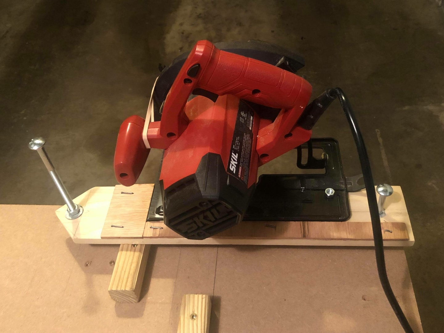 a circular saw bolted to a jig that makes it into a chop saw