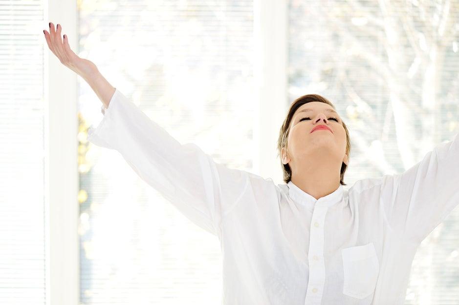 woman breathing in air