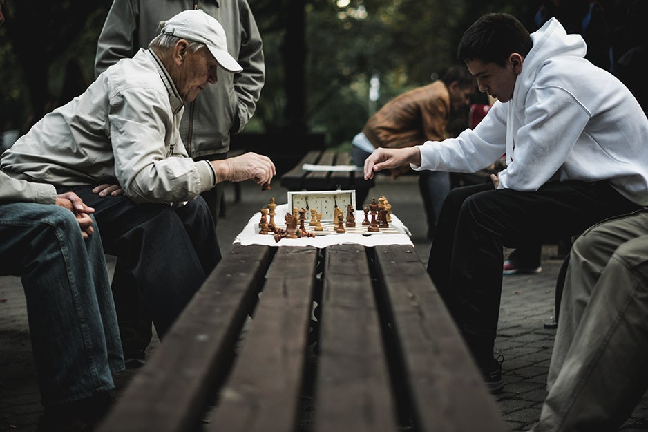 people playing chess in the park
