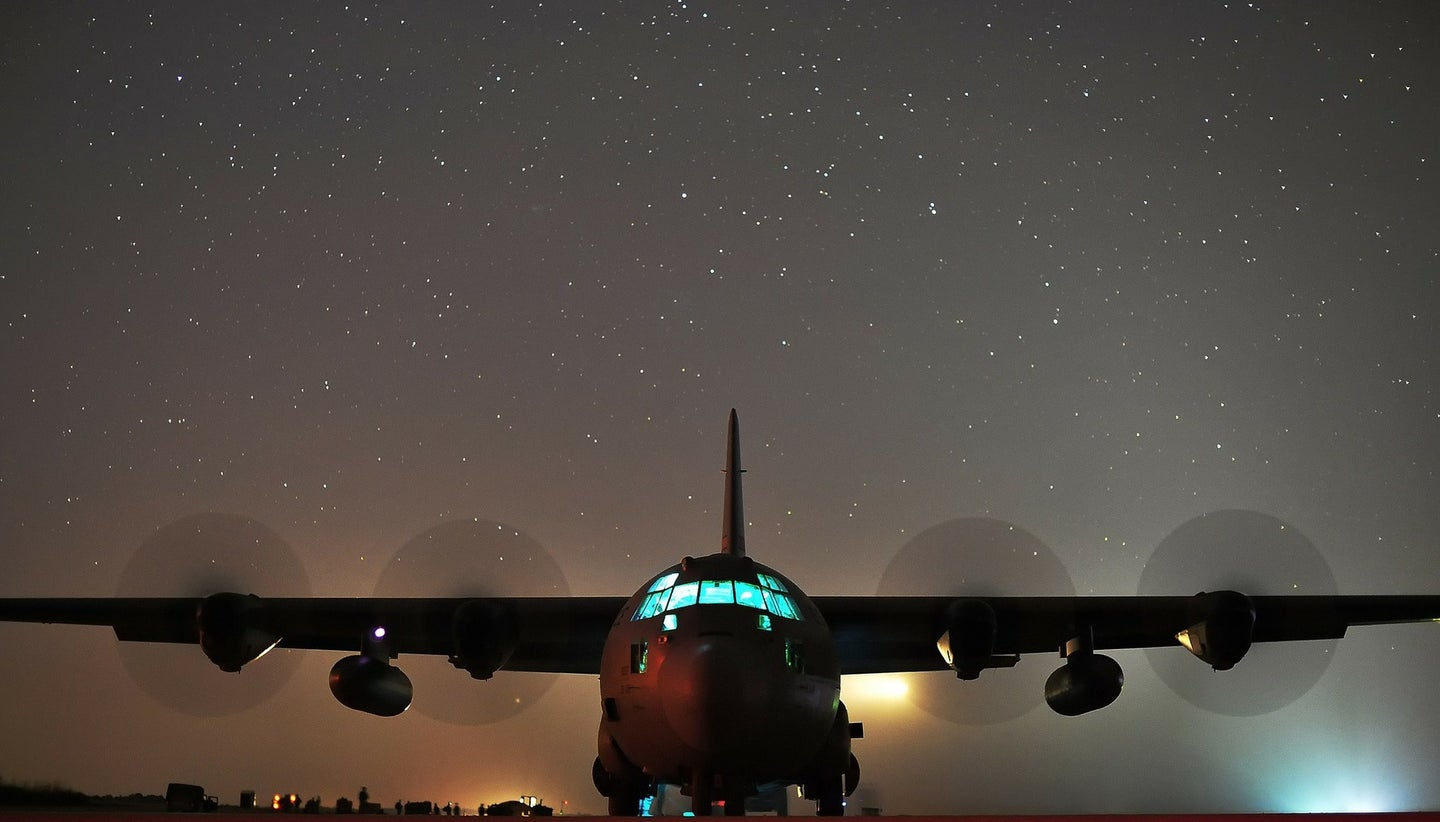 image of an airplane in front of a night sky