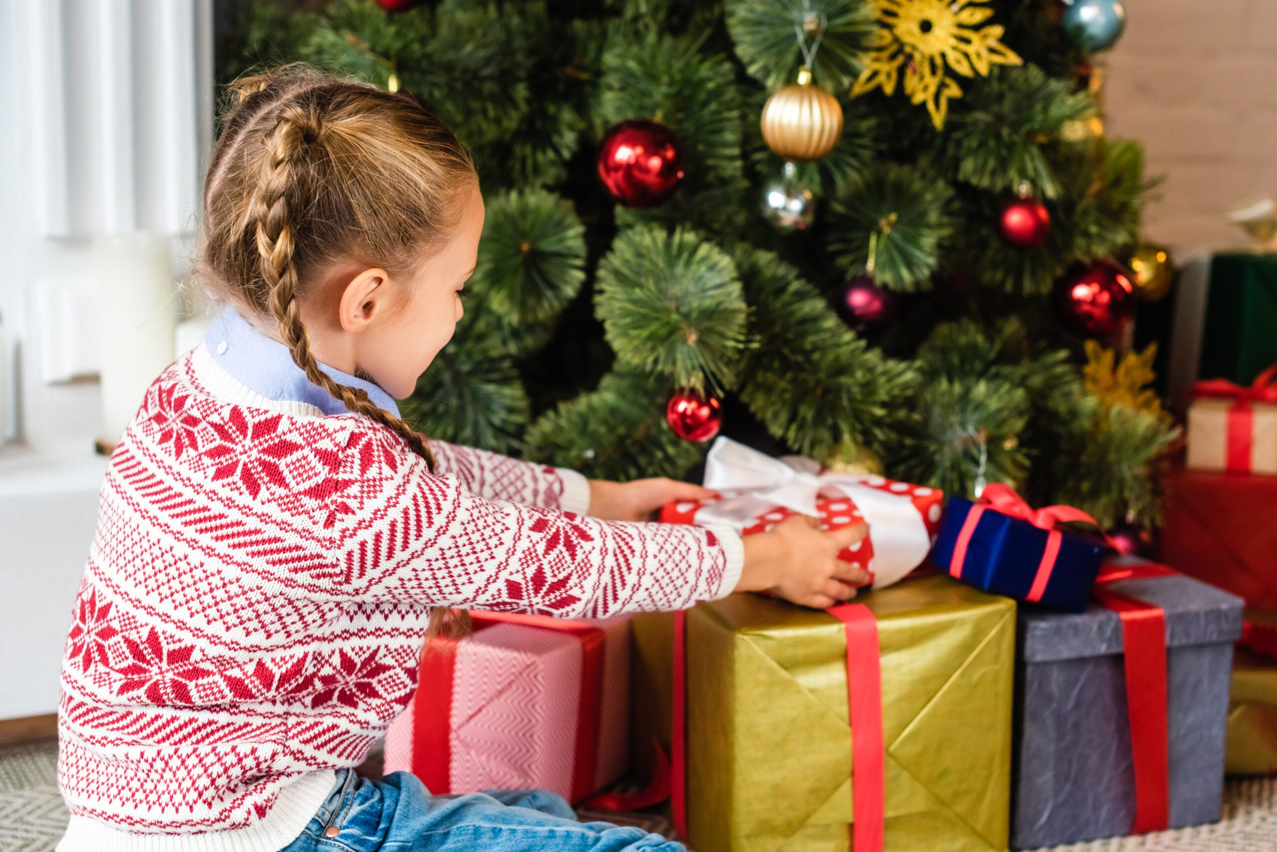 Christmas tree presents and child.