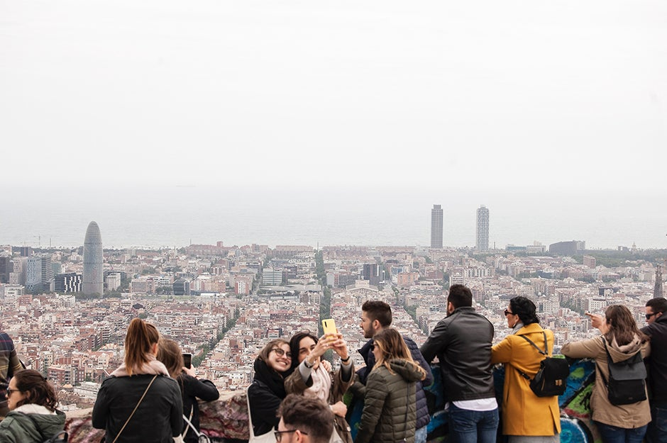 People taking photos near a ledge