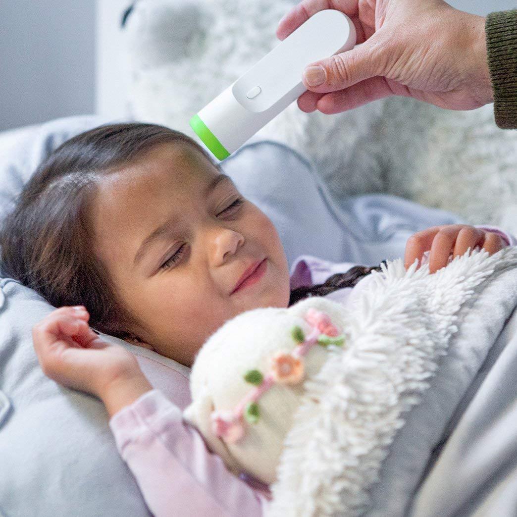child getting temperature taken.