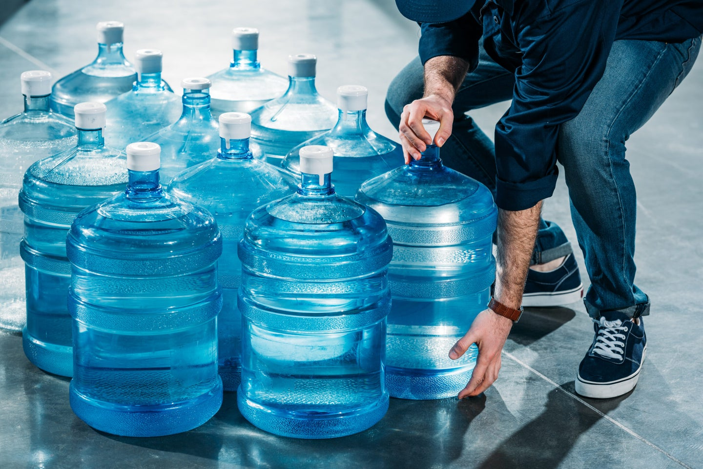 man delivering drinking water in jugs