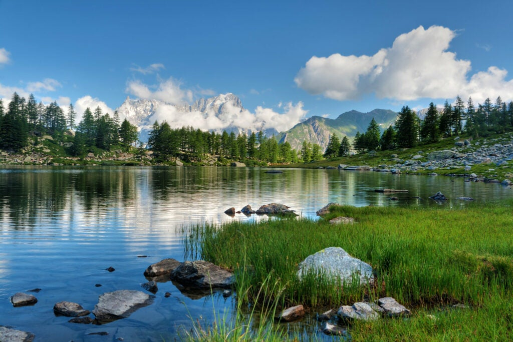 summer view of Arpy Lake near La Thuile, Aosta valley, Italy, a lake near mountains
