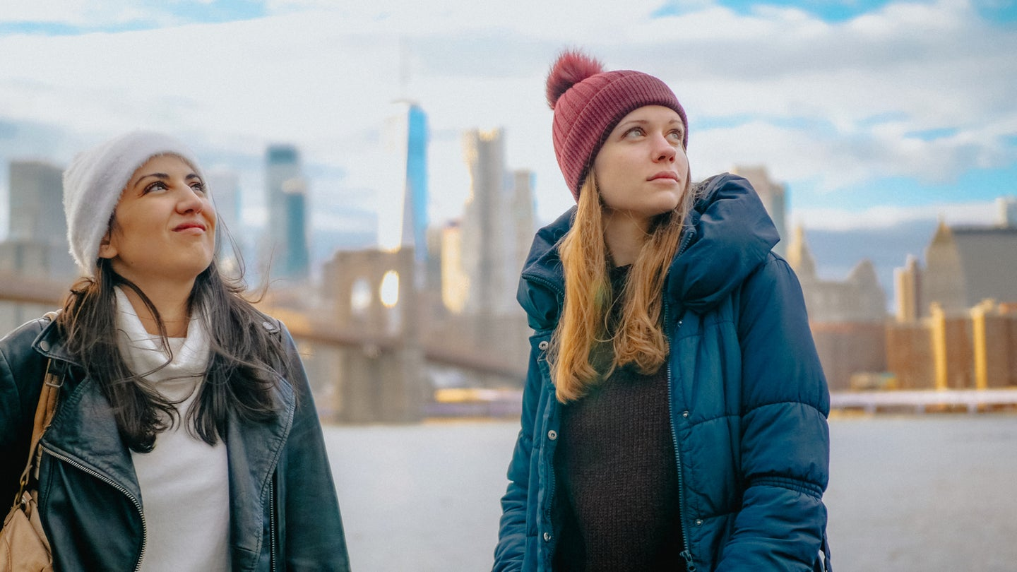 Two friends in New York enjoy the amazing view over the skyline of Manhattan