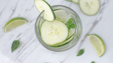 jar of cucumber water on white marble