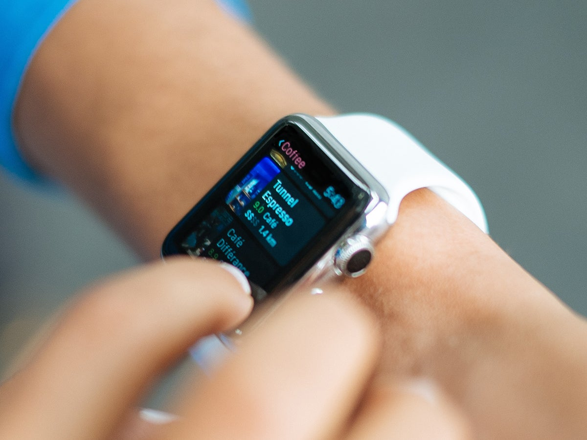 a person using a smartwatch on their wrist