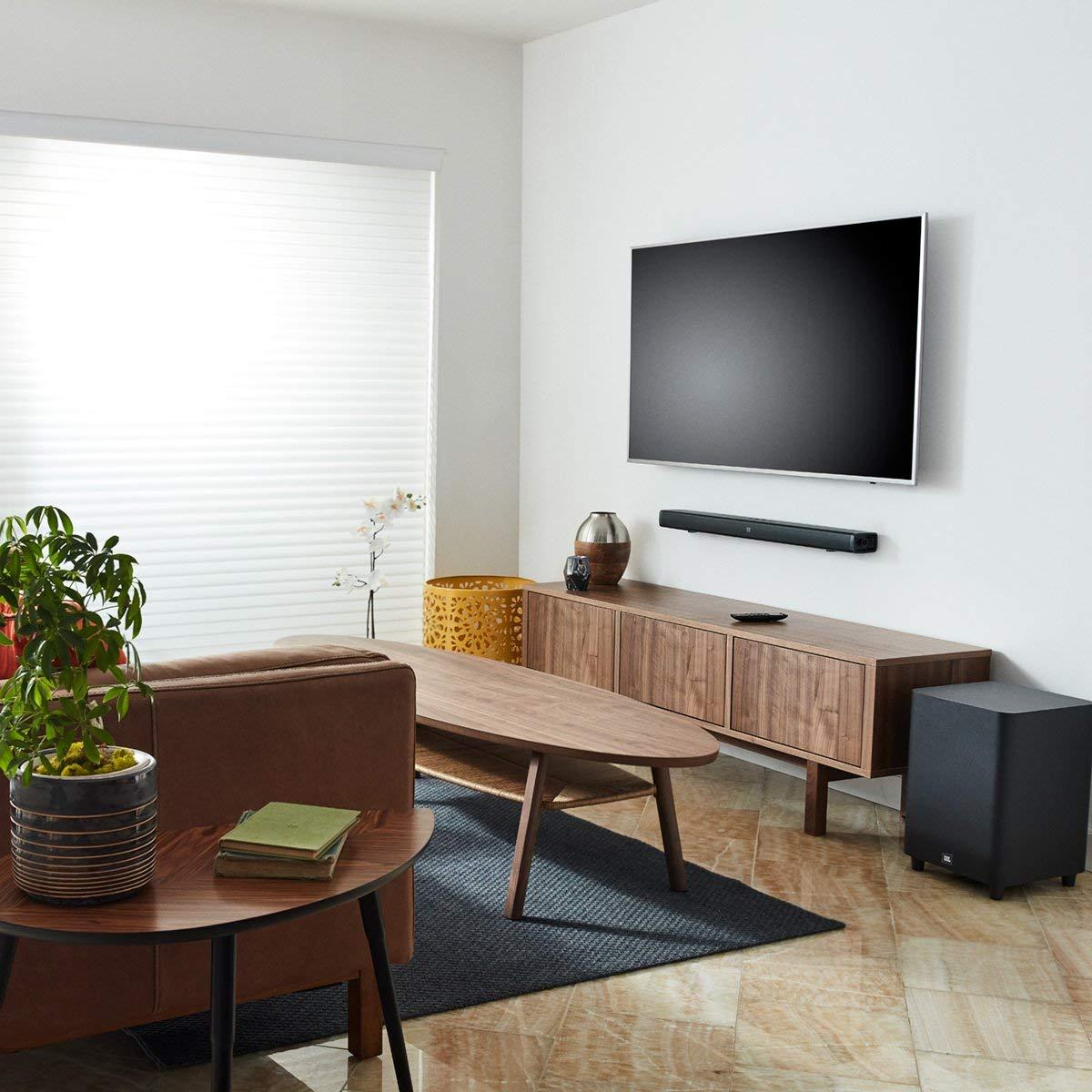 living room with a TV and soundbar