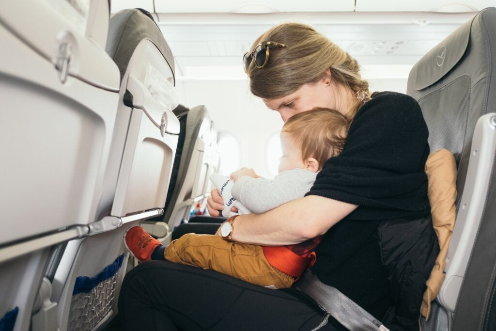 Mom with baby on a plane