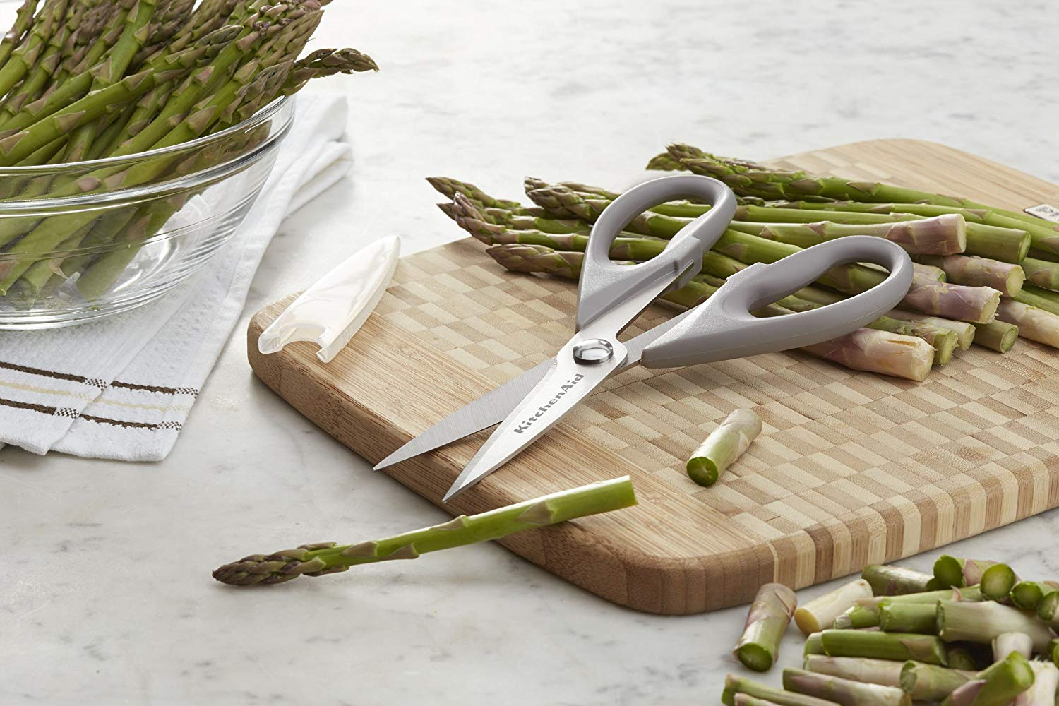 cutting board with asparagus and scissors