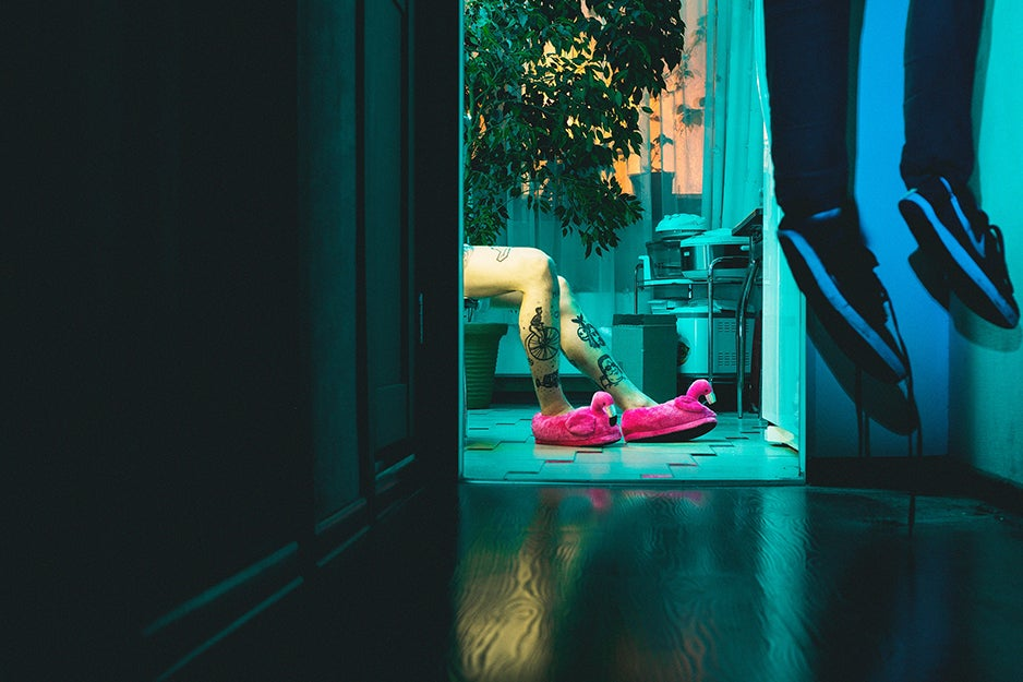 person wearing flamingo slippers