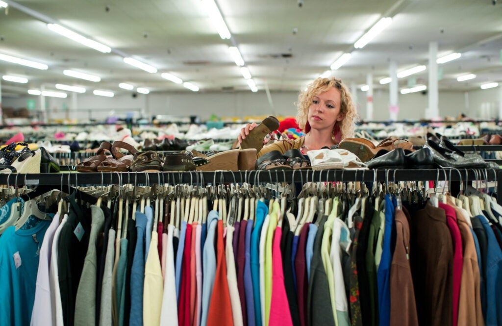 Person browsing in thrift store.