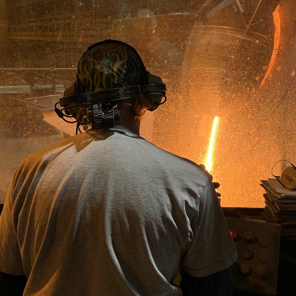 View from the induction furnace operator station. Steel is being melted in an induction furnace.