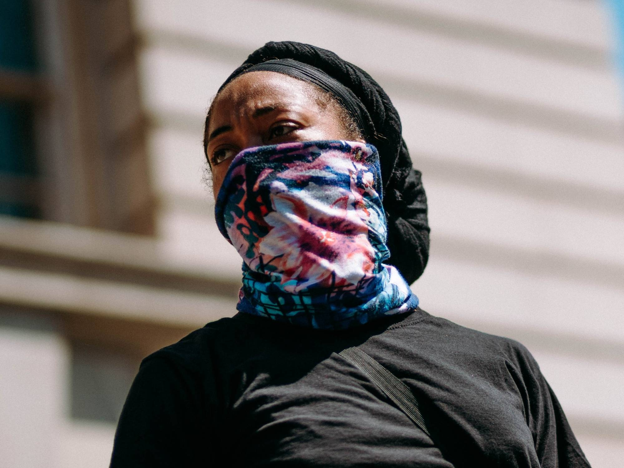 Person using neck gaiter as a mask
