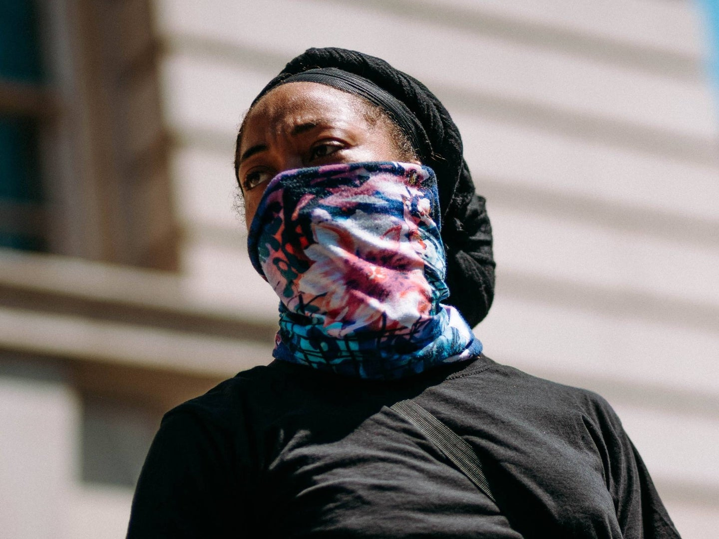 A person using a neck gaiter as a face mask.