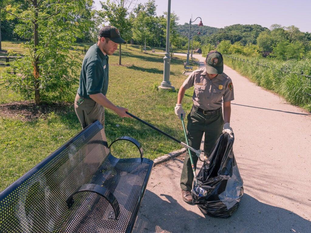 Park rangers picking up trash.