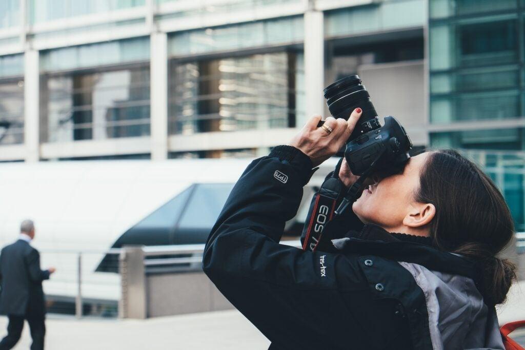 Photographer aiming camera upwards