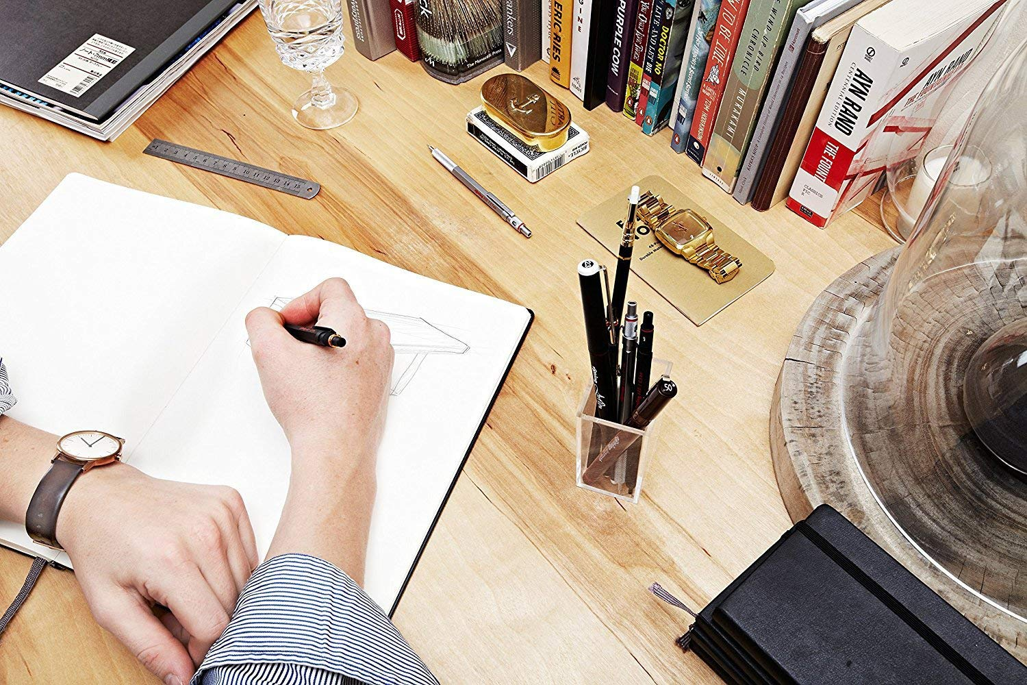 person drawing on a notepad