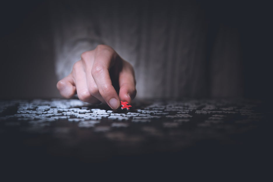jigsaw puzzle and a hand